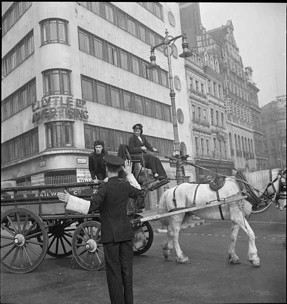 565px-Van_Girl-_Horse_and_Cart_Deliveries_For_the_London,_Midland_and_Scottish_Railway,_London,_England,_1943_D16829